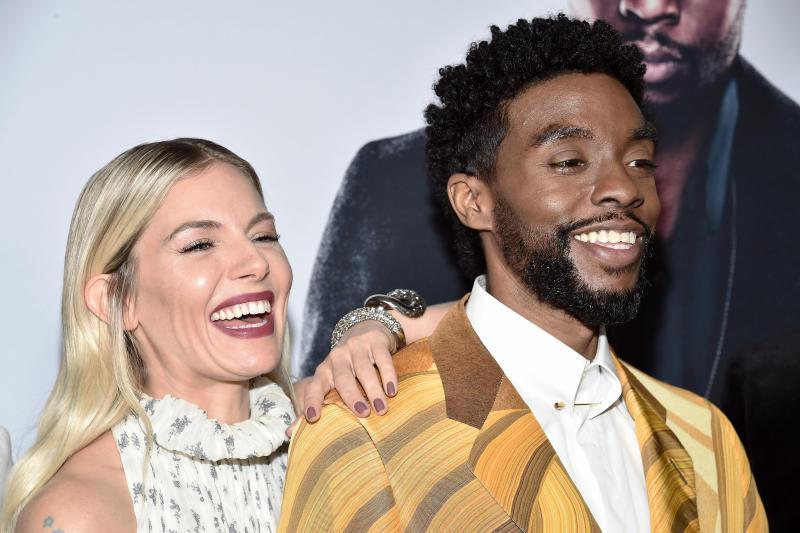 "NEW YORK, NEW YORK - NOVEMBER 19: Sienna Miller and Chadwick Boseman attend ""21 Bridges"" New York Screening at AMC Lincoln Square Theater on November 19, 2019 in New York City. (Photo by Steven Ferdman/WireImage)"