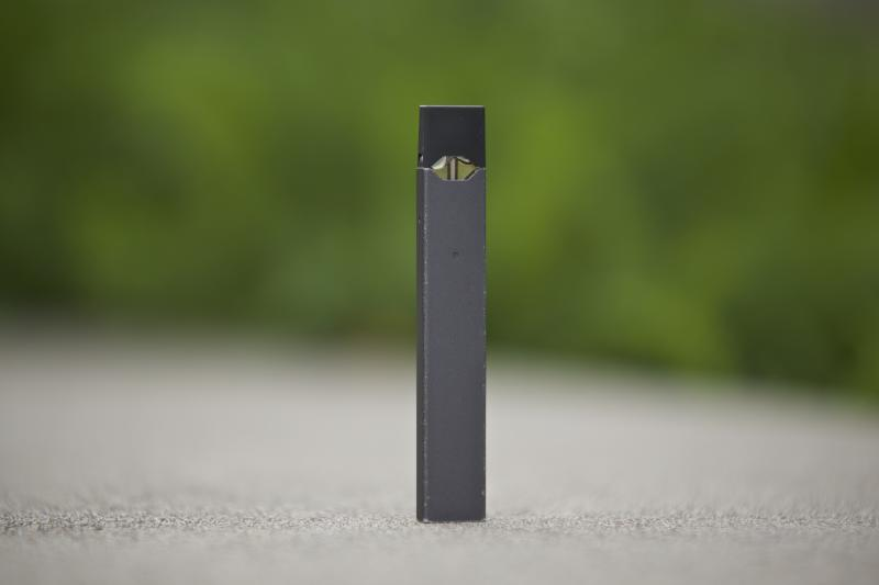 FILE - This April 16, 2019, file photo, shows a Juul vape pen in Vancouver, Wash. New research released on Tuesday, Nov. 5, 2019, shows U.S. teens who use electronic cigarettes prefer those made by Juul Labs, and mint is the favorite flavor for many of them, suggesting a shift after the company stopped selling fruit and dessert flavors in stores. (AP Photo/Craig Mitchelldyer, File)