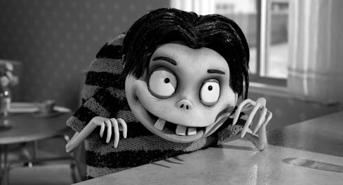 """This film image released by Disney shows Edgar """"E"""" Gore, voiced by Atticus Shaffer in a scene from """"Frankenweenie."""" (AP Photo/Disney)"""