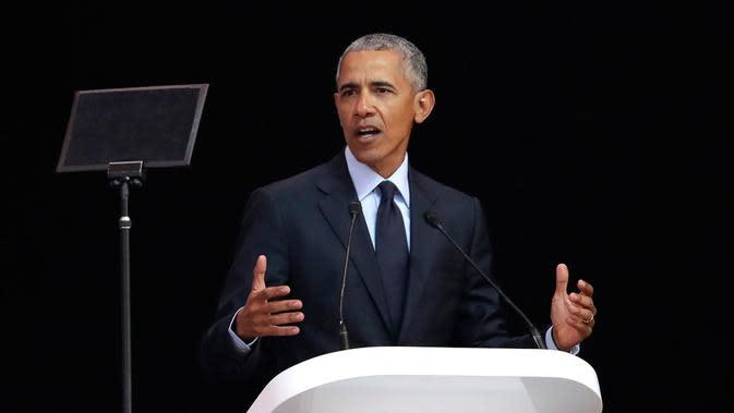 Barack Obama punya kebiasaan unik sebelum tidur. (AP Photo/Themba Hadebe/Henry)