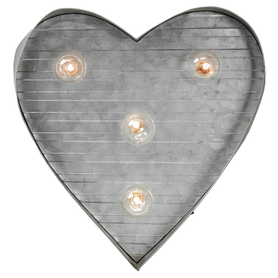 "<p>This <a rel=""nofollow"" href=""https://www.popsugar.com/buy/LED%20Light-Up%20Galvanized%20Metal%20Monogram%20Letter-404470?p_name=LED%20Light-Up%20Galvanized%20Metal%20Monogram%20Letter&retailer=pier1.com&price=50&evar1=moms%3Aus&evar9=45663736&evar98=https%3A%2F%2Fwww.popsugar.com%2Fmoms%2Fphoto-gallery%2F45663736%2Fimage%2F45663967%2FLED-Light-Up-Galvanized-Metal-Monogram-Letter&list1=shopping%2Cvalentines%20day%2Cdecor%20shopping%2Cpier%201%20imports&prop13=mobile&pdata=1"" rel=""nofollow"">LED Light-Up Galvanized Metal Monogram Letter</a> ($50) is big, bright, and Valentine's Day approved.</p>"