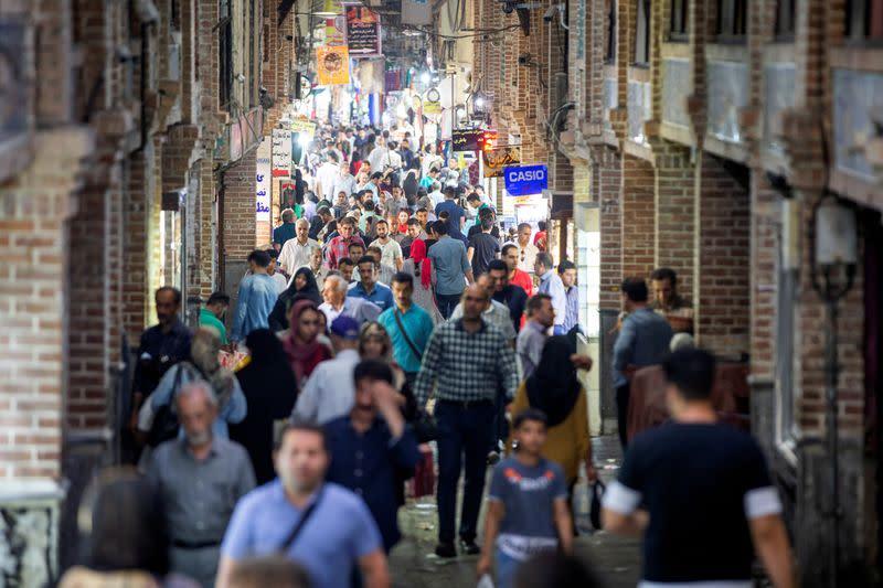 FILE PHOTO: People shop in a street called Grand Bazaar in downtown Tehran