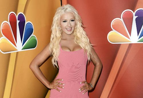 FILE - This July 27, 2013 file photo shows singer Christina Aguilera at the NBC 2013 summer press tour in Beverly Hills, Calif. Aguilera recently debuted her slimmed down body, but the singer admits she doesn't work out like crazy. The 32-year-old is on the cover of Maxim magazine's October issue. She's sporting a bra and shirt on the cover and fitted dress in the magazine spread. (Photo by Dan Steinberg/Invision/AP, File)