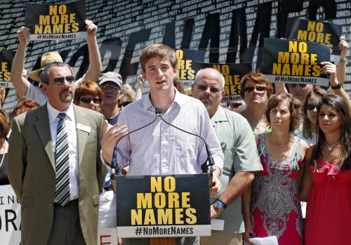 Steve Barton a survivor of the Aurora theater shooting speaks at a remembrance event marking the one-year anniversary of the theater shooting, at Cherry Creek State Park in Aurora, Colo., on Friday, July 19, 2013. Saturday, July 20 is the anniversary of the Aurora theater shootings. (AP Photo/Ed Andrieski)