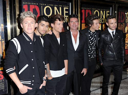 Niall Horan, Zayn Malik, Louis Tomlinson, Simon Cowell, Harry Styles and Liam Payne attend the UK Premiere of 'One Direction: This Is Us 3D' - VIP Arrivals, on Tuesday August 20, 2013, in London. (Photo by Jon Furniss/Invision/AP Images)