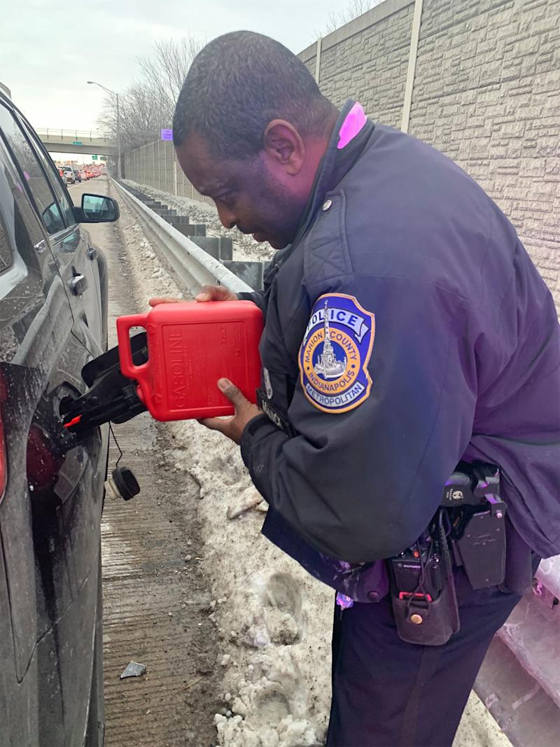 Random act of kindness: Police officer Michael Mack helped a driver who ran out of fuel in Indiana, mid west US.