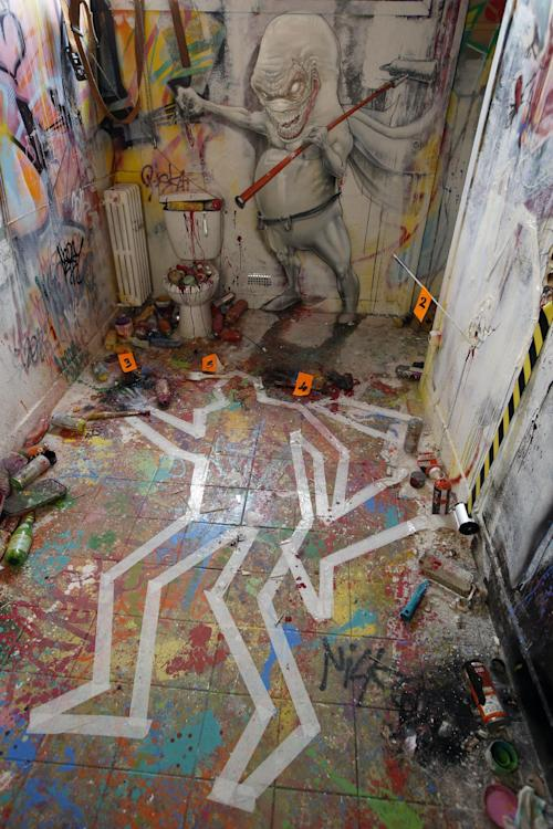 View of an installation in a social housing tower converted into a temporary street art exhibition in Paris, France, Tuesday, Oct. 8, 2013. Condemned apartments never looked so good _ and only rarely has graffiti met such an enthusiastic welcome. More than 80 artists were given free run of a rundown building that is doomed to destruction in 8 days. The line wraps around the block every day to see the apartments, each of which is its own art installation. (AP Photo/Francois Mori)