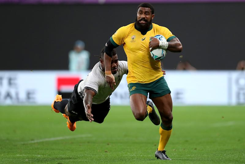 Marika Koroibete of Australia runs with the ball during the Rugby World Cup 2019 Group D game between Australia and Fiji at Sapporo Dome on September 21, 2019 in Sapporo, Hokkaido, Japan. (Photo by Dan Mullan/Getty Images)