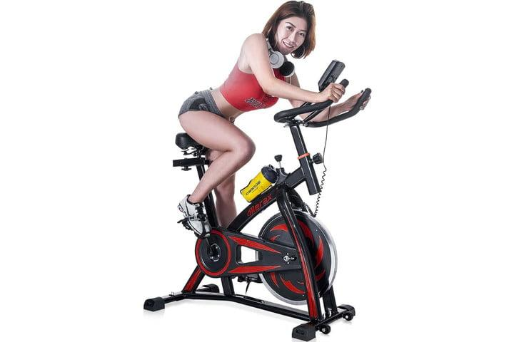woman riding merax-indoor-cycling-exercise-bike