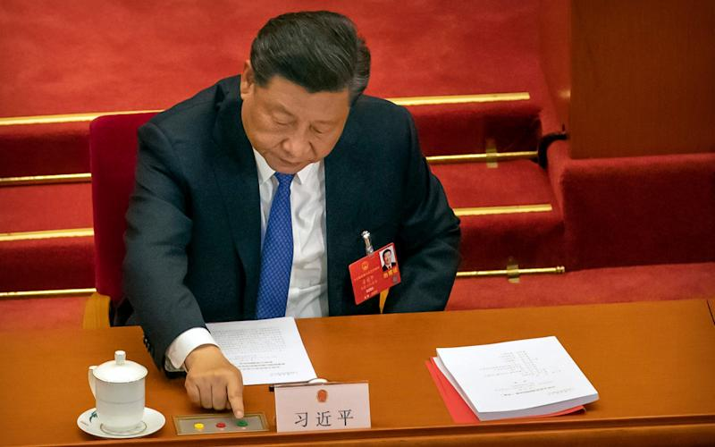 Xi Jinping voting to sign the security bill into law. The West says it will destroy Hong Kong's independence from Beijing - AP