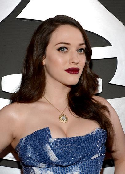 Kat Dennings' full chest have surely seen the light of day in that dress.