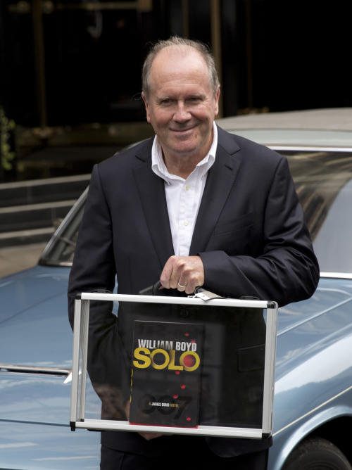 "William Boyd, the author of the new James Bond novel ""Solo"" poses for photographers, during a launch photocall outside the Dorchester Hotel in London, Wednesday, Sept. 25, 2013. ""Solo"" is set in 1969 and takes the suave British spy, 45 years old and feeling his age, from London's plush Dorchester Hotel to a war-torn West African country and to Washington. (AP Photo/Matt Dunham)"