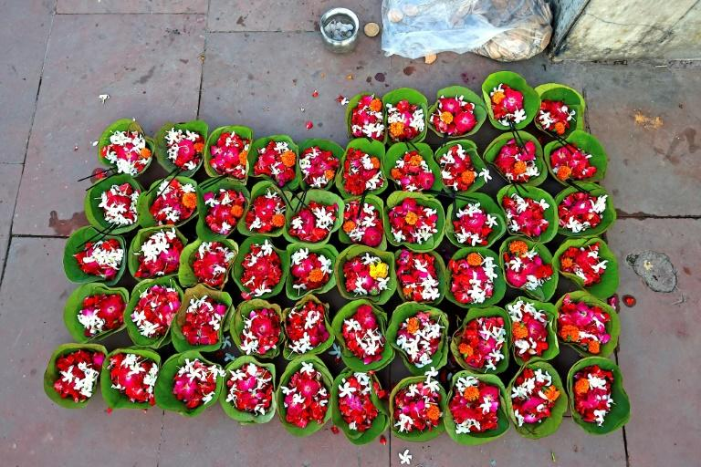 Flowers and incense sticks for sale at Har Ki Pauri on the banks of the Ganges as pilgrims trickle back to the holy site