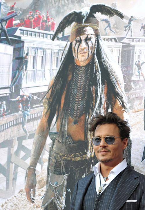 "In this Saturday, June 22, 2013 photo, Johnny Depp attends the world premiere of ""The Lone Ranger"" at Disney California Adventure in Anaheim, Calif. The Golden Globe-winning actor plays iconic Native American, Tonto, in the upcoming Disney reboot opening July 3. He said his children, Lily-Rose, 14, and Jack, 11, can't wait to see it. (Photo by John Shearer/Invision/AP)"