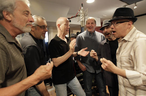 Musicians, from left, Don Ciccone, Lee Shapiro, Jimmy Ryan, Gerry Polci, Larry Gates and Russ Velazquez sing inside a studio, Sunday, May 13, 2012 in Fair Lawn, N.J. The men are part of the Four Seasons band, which is going on tour. (AP Photo/Julio Cortez)