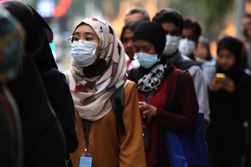Passengers wear masks at a bus station in Kuala Lumpur January 31, 2020. — Reuters pic