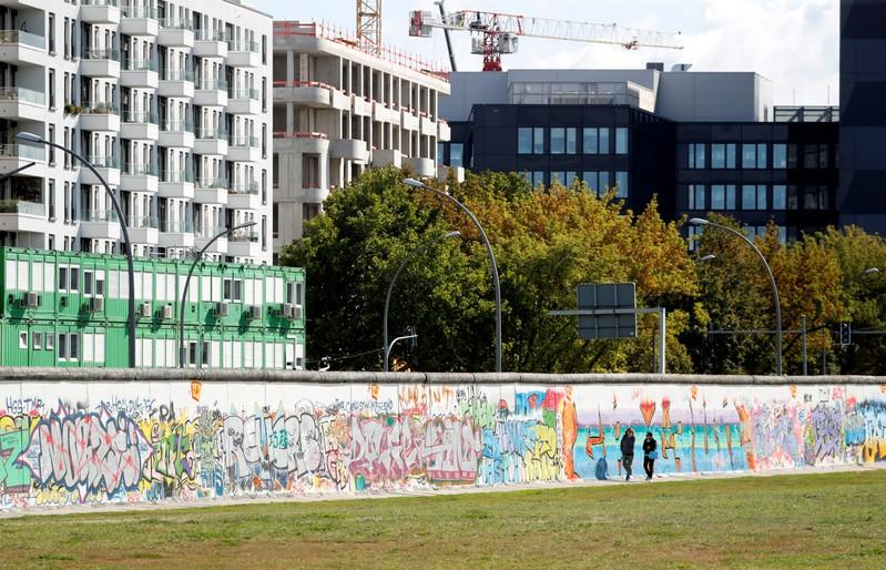 FILE PHOTO: New apartment and office buildings are pictured beside the East Side Gallery in Berlin