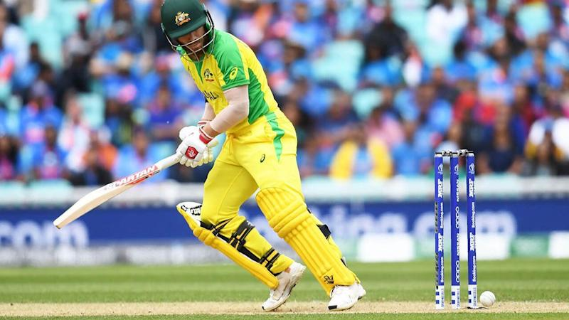 David Warner looks back as the ball touches his stumps but does not dislodge the bails. Pic: Getty