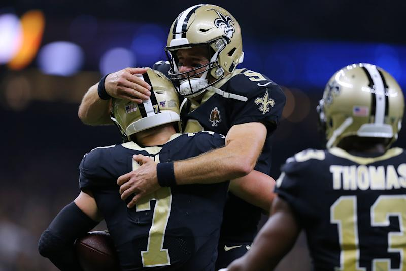 NEW ORLEANS, LOUISIANA - SEPTEMBER 09: Drew Brees #9 of the New Orleans Saints and Taysom Hill #7 celebrate a touchdown during the second half of a game against the Houston Texans at the Mercedes Benz Superdome on September 09, 2019 in New Orleans, Louisiana. (Photo by Jonathan Bachman/Getty Images)
