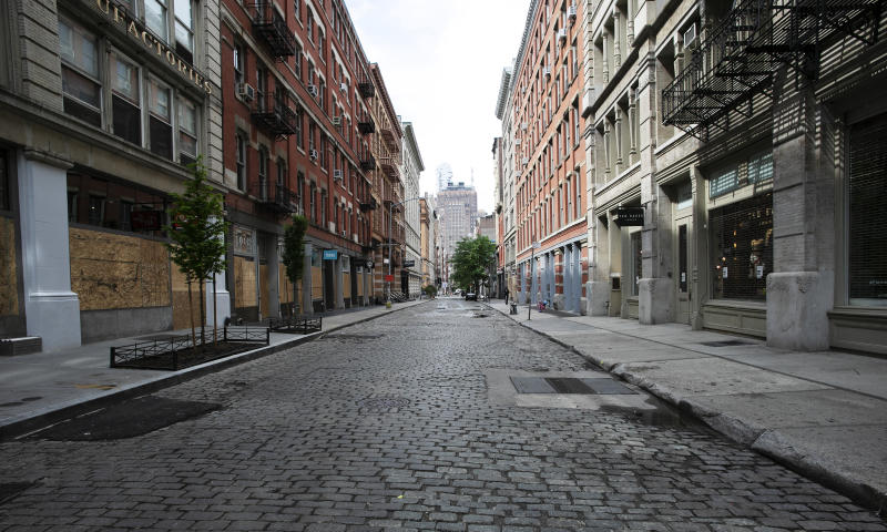 """A SoHo street is deserted, Wednesday, June 3, 2020, in New York. There's a certain kind of silent on the streets of Manhattan. Not the """"summertime and the living is easy"""" vacation lull, or the post-Christmas holidays letdown. It's the only-person-in-the-empty-house kind of quiet now. The New York City immortalized in song and scene has been swapped out for the last few months with the virus version. (AP Photo/Mark Lennihan)"""