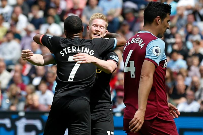 Manchester City's English midfielder Raheem Sterling (L) celebrates with Manchester City's Belgian midfielder Kevin De Bruyne (2L) after scoring their second goal during the English Premier League football match between West Ham United and Manchester City at The London Stadium, in east London on August 10, 2019. (Photo by Ian KINGTON / AFP) / RESTRICTED TO EDITORIAL USE. No use with unauthorized audio, video, data, fixture lists, club/league logos or 'live' services. Online in-match use limited to 120 images. An additional 40 images may be used in extra time. No video emulation. Social media in-match use limited to 120 images. An additional 40 images may be used in extra time. No use in betting publications, games or single club/league/player publications. / (Photo credit should read IAN KINGTON/AFP/Getty Images)