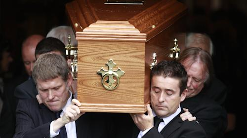Family members carry the coffin of Irish poet Seamus Heaney from the Church of the Sacred Heart in Donnybrook, Dublin, Ireland, Monday, Sept. 2, 2013. Ireland mourned the loss of its Nobel laureate poet, Seamus Heaney, with equal measures of poetry and pain Monday in a funeral full of grace notes and a final message from the great man himself: Don't be afraid. Among those packing the pews of Dublin's Catholic Church of the Sacred Heart were government leaders from both parts of Ireland, poets and novelists, Bono and The Edge from rock band U2, and former Lebanese hostage Brian Keenan. Heaney won the Nobel Prize for literature in 1995 in recognition of his wide-ranging writings inspired by the rural wonders of Ireland, the strife of his native Northern Ireland, the ancient cultures of Europe, of Catholic faith and Celtic mysticism, and the immutability of family ties. He died Friday in a Dublin hospital at the age of 74. (AP Photo/Peter Morrison)