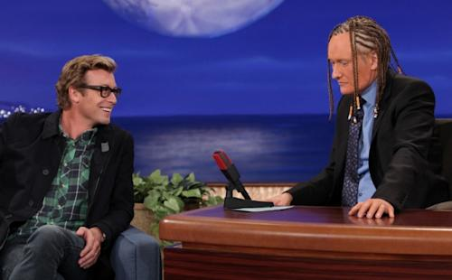 Guest Simon Baker of 'The Mentalist' marvels at Conan O'Brien's cornrows and spray tan on 'Conan,' Oct. 25, 2012 -- TNT