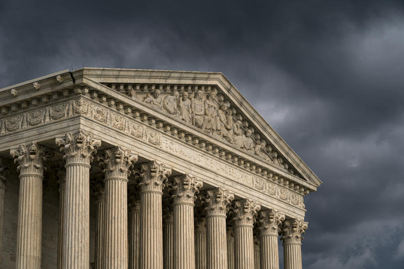 FILE - In this June 20, 2019, file photo, the Supreme Court in Washington. The Supreme Court is leaving in place the public nudity convictions of three women who removed their bathing suit tops on a New Hampshire beach as part of a campaign advocating for the rights of women to go topless. The justices declined Monday to review a state court decision that found no violation of the women's constitutional rights.  (AP Photo/J. Scott Applewhite, File)