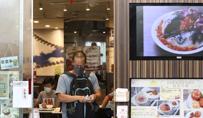 A customer leaves a restaurant in Causeway Bay on Friday. Photo: Xiaomei Chen