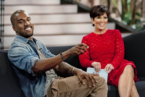 "This Aug. 19, 2013 photo shows singer Kanye West, left, with host Kris Jenner during a taping of her talk show ""Kris,"" in Culver City, Calif. West proclaims his love for Jenner's daughter, Kim Kardashian, and their daughter North in the interview airing Friday, Aug. 23. (AP Photo/20th Century Television, Barry J. Holmes)"