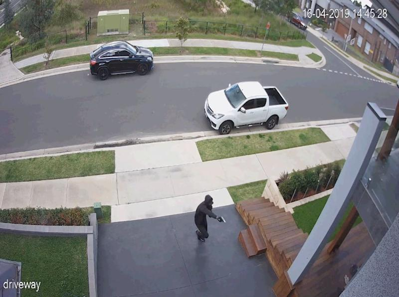 A gunman is seen on the footage opening fire at a man in Caddens. Source: NSW Police