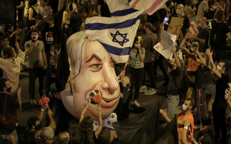 Israelis protest against Israeli prime minister Benjamin Netanyahu outside his residence in Jerusalem - ABIR SULTAN/EPA-EFE/Shutterstock