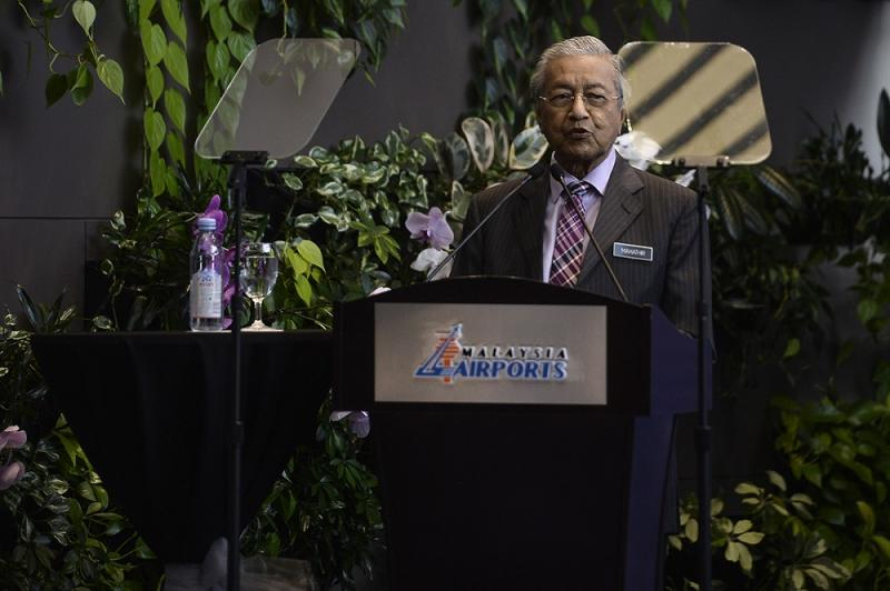 Prime Minister, Tun Dr Mahathir Mohammad speaks during the 21st Anniversary celebration of the KL International Airport in Sepang August 13, 2019. — Picture by Miera Zulyana