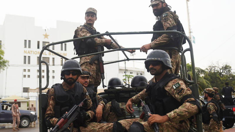 Soldiers, pictured here fully armed on the way to the ground in Karachi.
