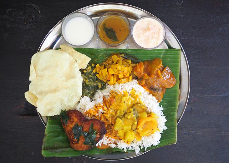You can truly create your own banana leaf rice meal at home with all the vegetables, pappadum, raita, 'rasam' and fried fish – Pictures by Lee Khang Yi