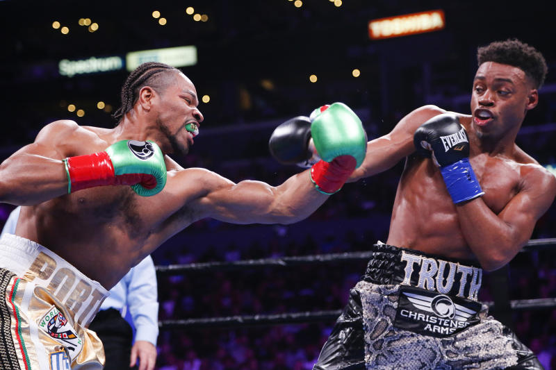 Errol Spence Jr., right, and Shawn Porter exchange punches during the WBC & IBF World Welterweight Championship boxing match Saturday, Sept. 28, 2019, in Los Angeles. (AP Photo/Ringo H.W. Chiu)