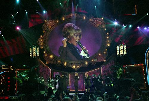 In this photo provided by the Las Vegas News Bureau, Whitney Houston performs during the Billboard Awards at the MGM Grand in Las Vegas on Dec. 7, 1998. Often referred to as the Queen of Pop music at her best, Houston ex-wife of singer Bobby Brown, died Saturday, Feb. 11, 2012 at the age of 48. (AP Photo/Las Vegas News Bureau Archives)