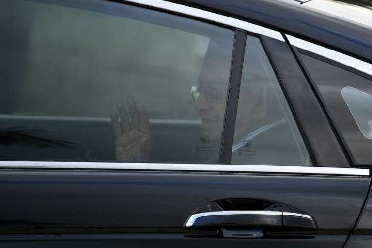 Malaysia's former prime minister Mahathir Mohamad waves as he leaves the National Palace in Kuala Lumpur after the king accepted his shock resignation -- but named Mahatir interim leader until a new prime minister is found