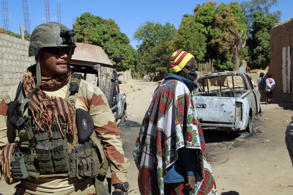 A French soldier secures a perimeter on the outskirt of Diabaly,  Mali, some  460kms (320 miles) north of the capital Bamako Monday Jan. 21, 2013.  French and Malian troops were in the city whose capture by radical Islamists prompted the French military intervention. (AP Photo/Jerome Delay)