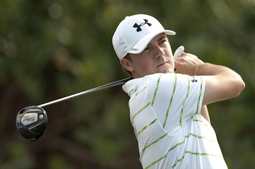 Jordan Spieth follows his drive off on the first tee during the third round of the Tournament of Champions golf tournament, Sunday, Jan. 5, 2014, in Kapalua, Hawaii. (AP Photo/Marco Garcia)
