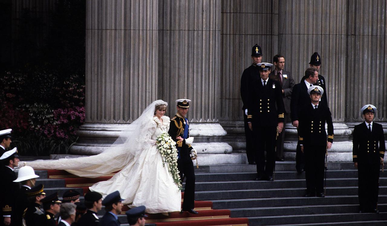 """<p>As Lady Diana Spencer stepped out of Clarence House on July 29, 1981, reporters everywhere ripped open sealed envelopes revealing the <a href=""""https://news.google.com/newspapers?id=BjtLAAAAIBAJ&sjid=OCINAAAAIBAJ&dq=diana%20wedding&pg=2406%2C7438391"""" target=""""_blank"""">""""most closely guarded secret in fashion history.""""</a> Details about the design of the future Princess of Wales' wedding dress managed to remain under lock and key until hours before the ceremony, and the dramatic unveiling did not disappoint.</p><p>The ivory taffeta gown later sparked copycats around the world, cementing the over-the-top, all-about-frills aesthetic '80s bridal was best known for. With elaborate embroidery, 10,000 pearls, and a 25-foot-long train, Diana's custom wedding dress that she wore during her nuptials to Prince Charles has undoubtedly become the most iconic in modern history. Here, everything you need to know about Princess Diana's wedding gown—from the intricacies of the design to the secrets that have emerged over time. <br></p>"""