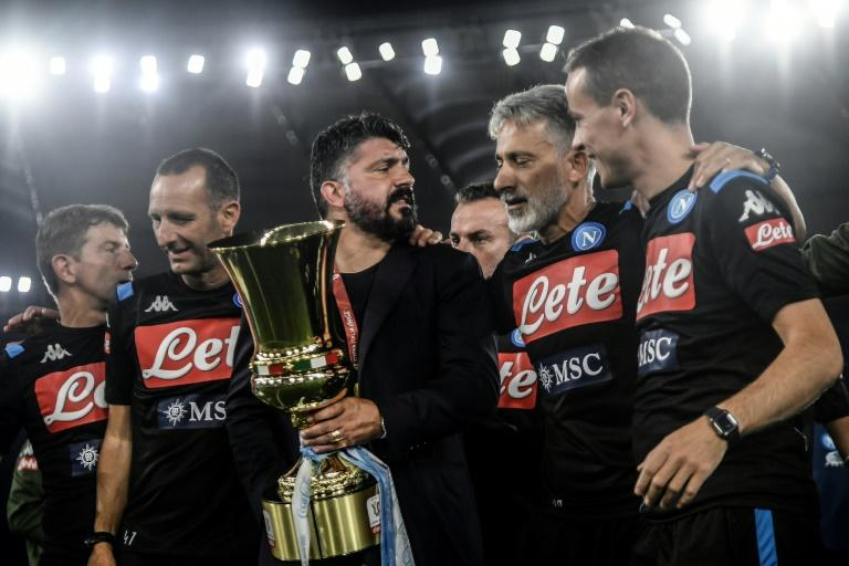Gennaro Gattuso (C with Italian Cup trophy) took over from Carlo Ancelotti as Napoli coach in December