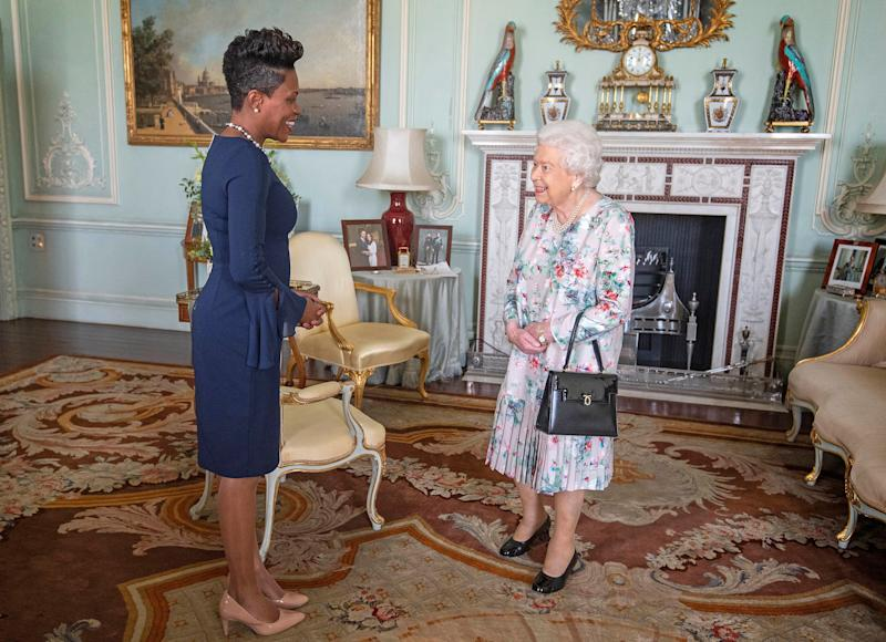 Britain's Queen Elizabeth II (R) greets High Commissioner for Grenada, Lakisha Grant, during a private audience at Buckingham Palace in central London on October 22, 2019. (Photo by Victoria Jones / POOL / AFP) (Photo by VICTORIA JONES/POOL/AFP via Getty Images)