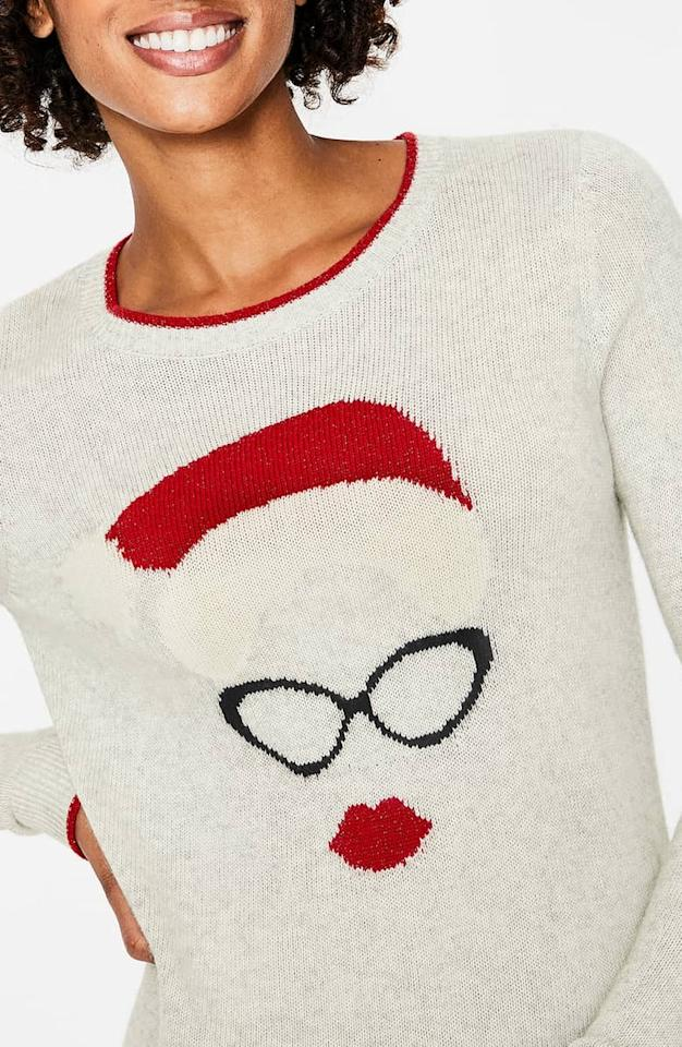 """<p>This cozy <a rel=""""nofollow"""" href=""""https://www.popsugar.com/buy/Boden%20Holiday%20Sweater-395438?p_name=Boden%20Holiday%20Sweater&retailer=shop.nordstrom.com&price=110&evar1=moms%3Aus&evar9=45559600&evar98=https%3A%2F%2Fwww.popsugar.com%2Fmoms%2Fphoto-gallery%2F45559600%2Fimage%2F45559606%2FBoden-Holiday-Sweater&list1=shopping%2Csweaters%2Choliday%2Cchristmas%2Cwinter%2Cwinter%20fashion&prop13=desktop&pdata=1"""" rel=""""nofollow"""">Boden Holiday Sweater</a> ($110) shows off a more glamorous Santa, with cat-eye glasses and a red lip!</p>"""