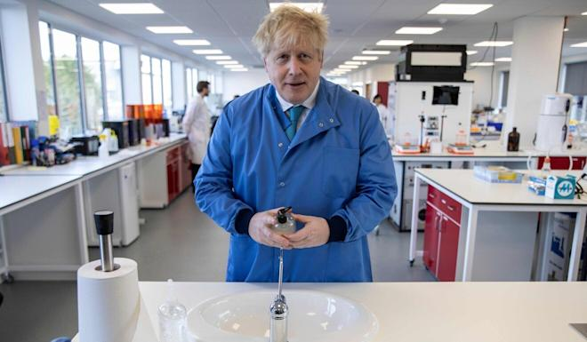 Britain's Prime Minister Boris Johnson o March 6 during a visit to the Mologic Laboratory in the Bedford technology Park, north of London. Photo: AFP