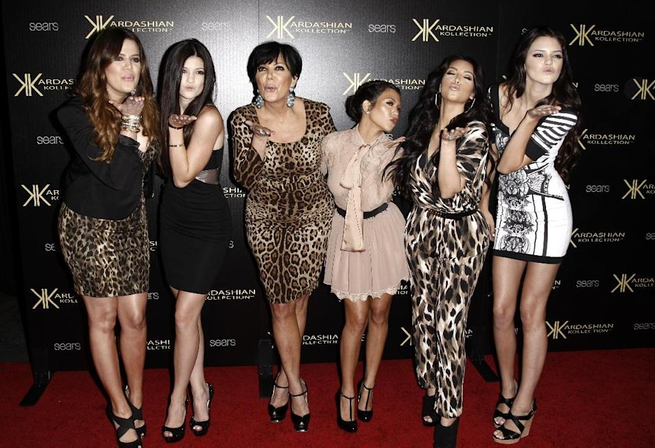 "FILE - In this Aug. 17, 2011 file photo, from left, Khloe Kardashian, Kylie Jenner, Kris Jenner, Kourtney Kardashian, Kim Kardashian, and Kendall Jenner arrive at the Kardashian Kollection launch party in Los Angeles. The E! Entertainment network said Tuesday it had reached a deal with its most bankable franchise to make three more seasons of ""Keeping Up With the Kardashians."" (AP Photo/Matt Sayles, file)"