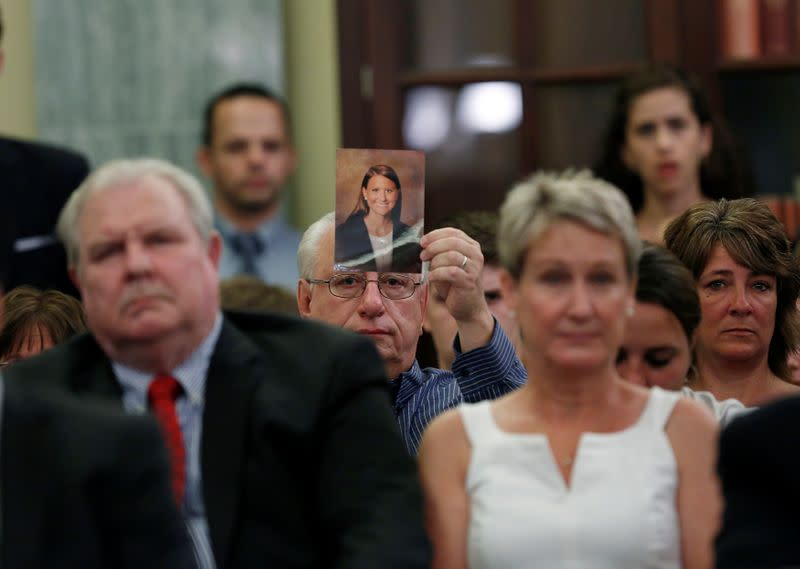 FILE PHOTO: A family member displays a photo of one of the victims of General Motors' ignition/air bag failure at the Senate Commerce, Science and Transportation Subcommittee in Washington