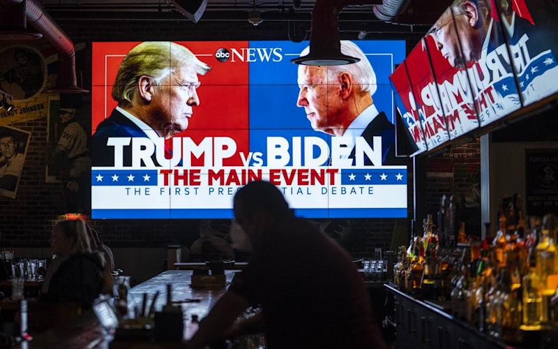 A TV screen displays the first presidential debate - Sarah Silbiger/Getty Images