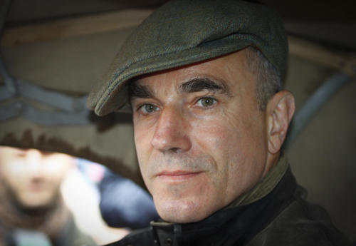 "FILE - British actor Daniel Day-Lewis waits at the start of the Mille Miglia historic car race, in a Thursday, May 16, 2011 file photo, in Brescia, Italy. British writer William Boyd, who has written a new official James Bond novel authorized by creator Ian Fleming's family, says Day-Lewis would be perfect to play the 007 he has created in ""Solo."" (AP Photo/Spada, Lapresse, File) ITALY OUT"