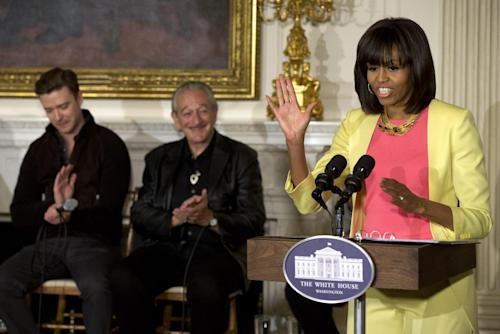 "Singers Justin Timberlake, left, and Charlie Musselwhite, listen as first lady Michelle Obama introduces the panel for the workshop, ""Soulsville, USA: The History of Memphis Soul,"" Tuesday, April 9, 2013, in the State Dining Room of the White House in Washington. The workshop for students was before tonight's ""In Performance at the White House: Memphis Soul"". (AP Photo/Jacquelyn Martin)"